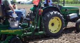 Large ndsu team members on tractor